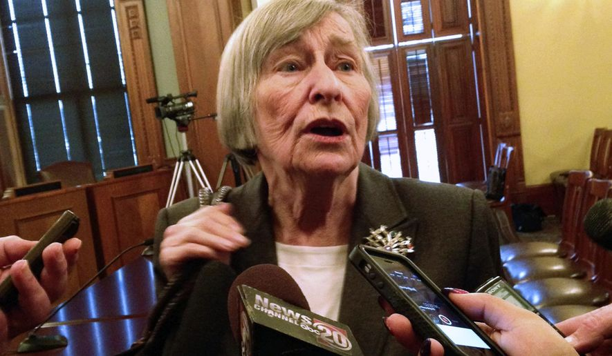 FILE - In this March 24, 2015 file photo, state Rep. Barbara Flynn Currie, D-Chicago, speaks to reporters at the state Capitol in Springfield, Ill. Top Democrats are warning that Illinois will run out of money to operate in just a few months if lawmakers can't agree on a state budget. But they still insist they won't cave to Gov. Bruce Rauner's demands to weaken public-worker unions to get a budget deal. Currie said Wednesday, Oct. 8, 2015, the Republican governor's plan to let local governments opt out of collective bargaining is an attack on the middle class.  (AP Photo/Kerry lester, File)