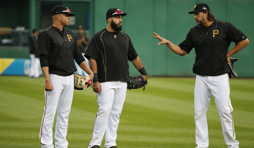 Pittsburgh Pirates first basemen Pedro Alvarez, center, Aramis Ramirez, left, and Sean Rodriguez, right, stand beside each other during batting practice before the National League Wild Card baseball game against the Chicago Cubs, Wednesday, Oct. 7, 2015, in Pittsburgh.  (AP Photo/Gene J. Puskar)