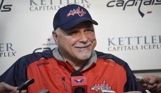 Washington Capitals head coach Barry Trotz talks to reporters during Media Day at NHL hockey training camp, Friday, Sept. 18, 2015, in Arlington, Va. (AP Photo/Nick Wass)