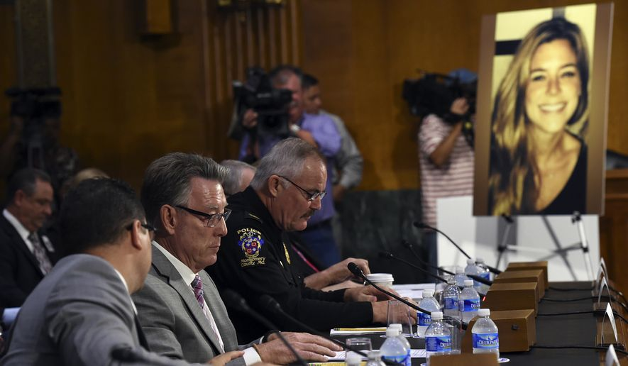 Jim Steinle, second from left, father of Kathryn Steinle, in photograph, testifies next to Montgomery County (Md.) Police Department. Chief J. Thomas Manger, right, before a Senate Judiciary hearing to examine the Administration's immigration enforcement policies, in Washington, Tuesday, July 21, 2015. Kathryn Steinle was killed on a San Francisco pier, allegedly by a man previously deported several times. (AP Photo/Molly Riley) ** FILE **