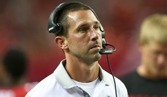 Atlanta Falcons offensive coordinator Kyle Shanahan watches the action during the second half of an NFL football preseason game Tennessee Titans, Friday, Aug. 14, 2015, in Atlanta. (AP Photo/John Bazemore)