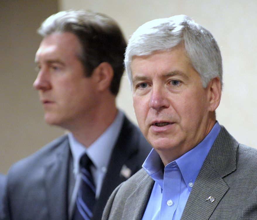 Mich. Gov. Rick Snyder announces support in the city of Flint's plan to switch back to Detroit water due to high lead levels during a news conference in Flint, Mich. on Thursday Oct. 8, 2015.  Flint stopped using water from the Detroit system last year as a cost-cutting measure, opting instead for a supply direct from the Flint River.  (Christian Randolph/The Flint Journal-MLive.com via AP) LOCAL TELEVISION OUT; LOCAL INTERNET OUT; MANDATORY CREDIT