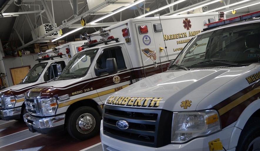 ADVANCE FOR SATURDAY, OCT. 10 AND THEREAFTER - In a June 30, 2015 photo shows ambulances at Narberth Ambulance in Ardmore, Pa, For decades, volunteer ambulance companies were part of the fabric of community life. But the emergency services landscaping has changed, across the region and the country. Narberth Ambulance, also known as VMSC of Lower Merion and Narberth, has maintained a high level of staffing , both paid and volunteer, has 74 active volunteers who work alongside 41 long-term EMTs and paramedics.  (Tom Gralish/The Philadelphia Inquirer via AP )