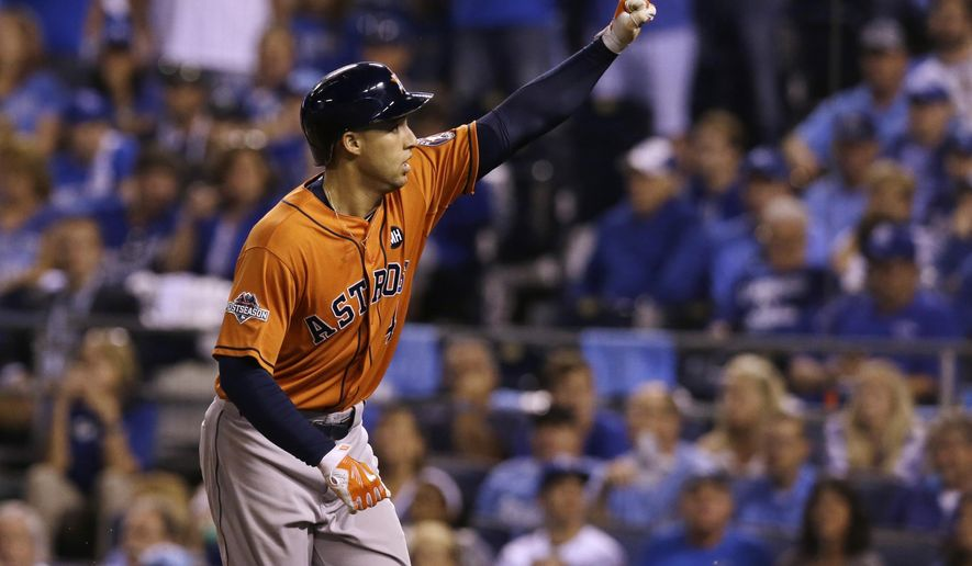 Houston Astros' George Springer celebrates after his solo home run during the fifth inning in Game 1 of baseball's American League Division Series against the Kansas City Royals, Thursday, Oct. 8, 2015, in Kansas City, Mo. (AP Photo/Orlin Wagner)
