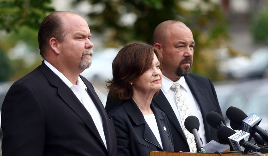Douglas County Commissioners Tim Freeman, from left, Susan Morgan and Chris Boice hold a news conference in Roseburg, Ore., Wednesday, Oct. 7, 2015. President Obama plans to travel to Roseburg on Friday to meet with victims' families. Obama's calls for stricter gun laws in the wake of the shootings did not sit well with many people in this conservative region, where gun ownership is pervasive. The county commissioners tried to tamp down any suggestion that Obama was not welcome. (Michael Sullivan/The News-Review via AP) MANDATORY CREDIT