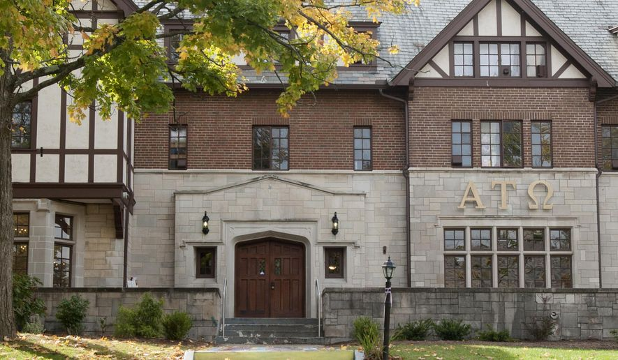 Indiana University officials said Thursday, Oct. 8, 2015 it has suspended the Alpha Tau Omega fraternity in Bloomington, Ind., following allegations of misconduct during a hazing ritual involving a male pledge performing a sex act on a woman in front of a crowd. It wasn't immediately clear whether any criminal charges would be pursued. (David Snodgress/Bloomington Herald-Times via AP)