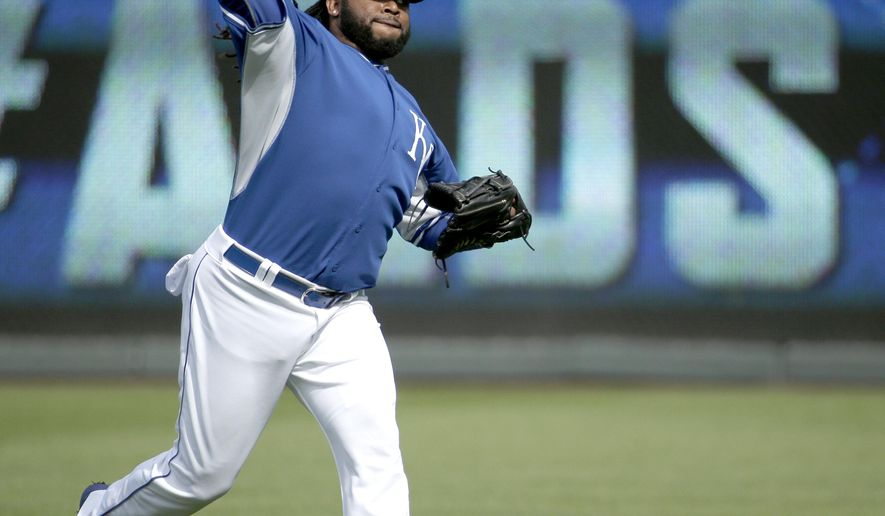 Kansas City Royals starting pitcher Johnny Cueto works out during baseball practice Wednesday, Oct. 7, 2015, in Kansas City, Mo. The Royals face the Astros in Game 1 of the ALDS Thursday in Kansas City. (AP Photo/Charlie Riedel)