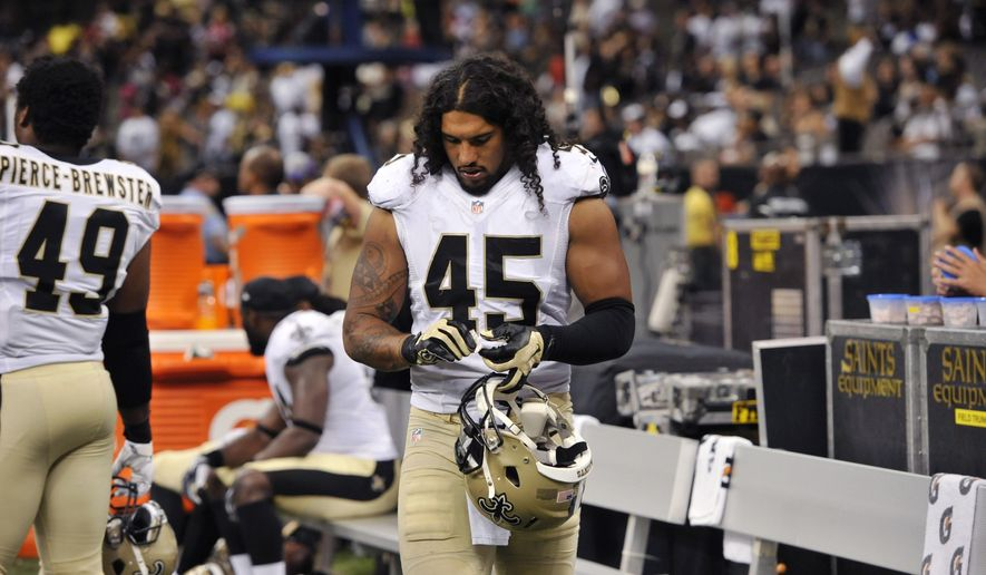 In this Aug. 22, 2015, photo, New Orleans Saints outside linebacker Hau'oli Kikaha (45) walks on the sideline in the second half of an NFL preseason football game against the New England Patriots in New Orleans. Kikaha projects a laid back, island vibe as he chats in front of his locker. On the field, the rookie outside linebacker has been intense and ferocious through his first four games, recording three sacks and forcing two fumbles. (AP Photo/Bill Feig)