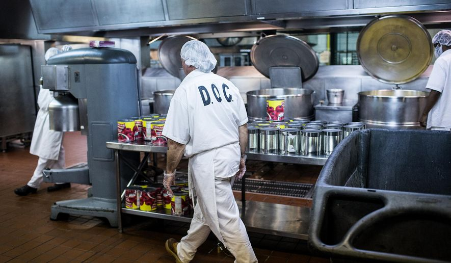 ADVANCE FOR USE SATURDAY, OCT. 10 - In this photo taken Aug. 29, 2015, inmates work in the kitchen at the State Correctional Institution in Coal Township, Pa. Even though some victims and others might begrudge giving inmates more than a bread and water diet, a lot of thought, attention and planning goes into feeding 51,000 inmates in Pennsylvania's state prisons. (Sean Simmers/PennLive.com via AP) MANDATORY CREDIT