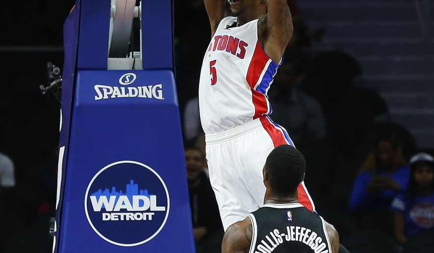 Detroit Pistons guard Kentavious Caldwell-Pope (5) dunks as Brooklyn Nets forward Rondae Hollis-Jefferson (24) looks on in the first half of an NBA preseason basketball game in Auburn Hills, Mich., Thursday, Oct. 8, 2015. (AP Photo/Paul Sancya)