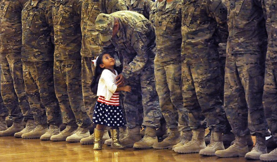 Karas Ogelsby had such a hard time waiting for the dismissal of the troops during a homecoming she broke away from her mom and ran to her father, Lt. Daniel Ogelsby at at Ft. Carson, in Colorado Springs, Colo, Tuesday, Oct. 6, 2015. Lt. Ogelsby gave her hug and gently sent her back to her mom until the end of the ceremony. Approximately 55 Ft. Carson soldiers from the 3rd Armored Brigade Combat Team, 4th I.D., returned from Southwest Asia on Tuesday.  (Jerilee Bennett/The Gazette via AP)