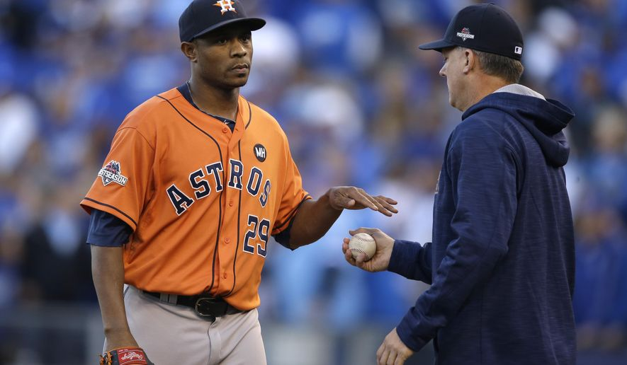 Houston Astros relief pitcher Tony Sipp, left, reacts as he is taken out by manager A.J. Hinch during the eighth inning of Game 2 in baseball's American League Division Series against the Kansas City Royals, Friday, Oct. 9, 2015, in Kansas City, Mo. (AP Photo/Orlin Wagner)