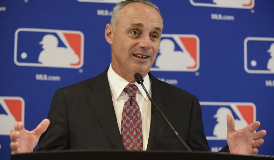 "FILE - In this Aug. 13, 2015, file photo, Major League Baseball Commissioner Rob Manfred speaks to the media after the owners meetings in Chicago. Manfred says it's ""not appropriate"" to enforce pace-of-play rules as strictly during the postseason. Speaking before Toronto hosted Texas in Game 2 of their AL Division Series, Manfred said he was pleased with cooperation from players during the regular season, when the average time of a nine-inning game was cut by six minutes this year to 2:56. (AP Photo/Paul Beaty, File)"