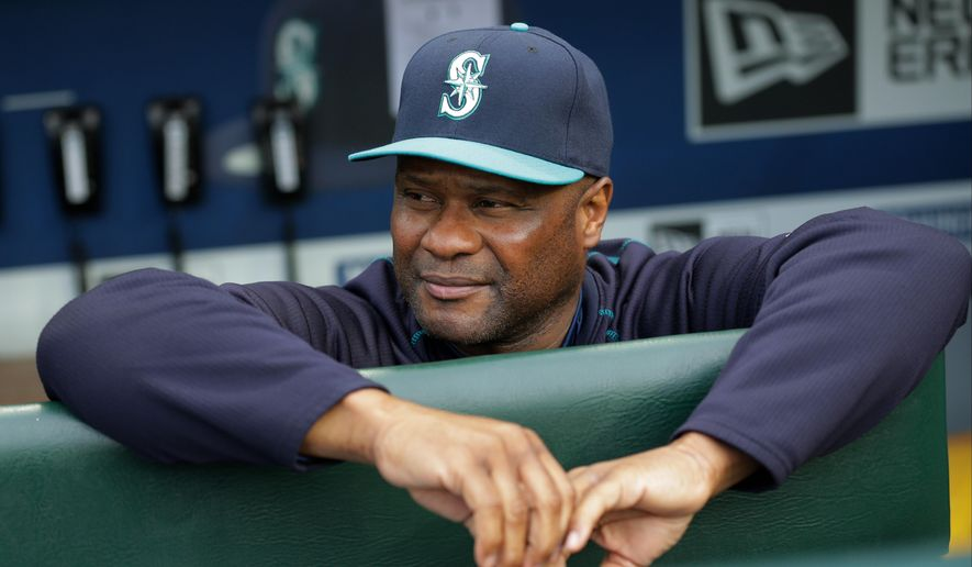FILE - In this May 15, 2015, file photo, Seattle Mariners' Lloyd McClendon leans on the dugout rail before a baseball game against the Boston Red Sox in Seattle. The Mariners have fired manager Lloyd McClendon after two seasons,  Friday, Oct. 9, 2015, less than a week after the Mariners concluded a disappointing 76-86 season. (AP Photo/Ted S. Warren, File)