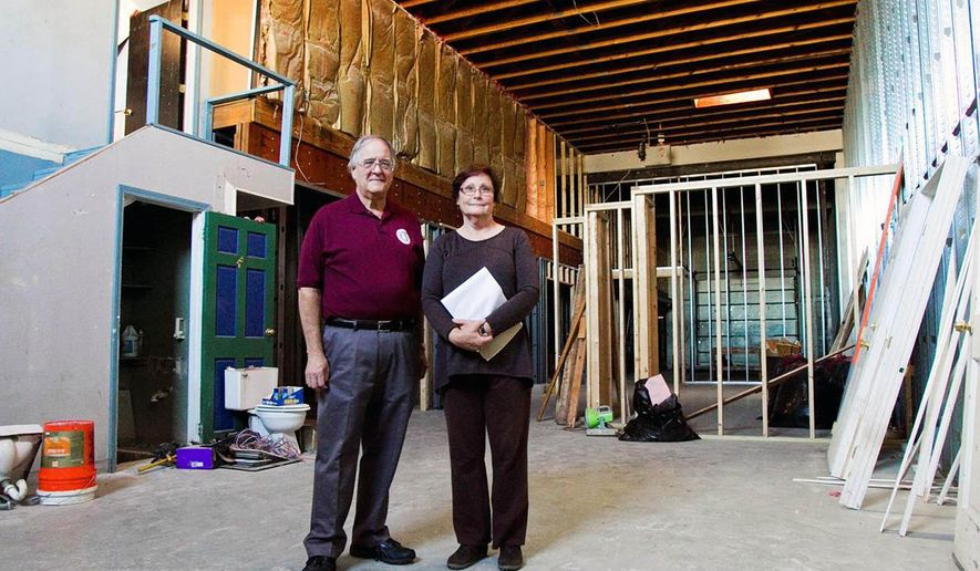 In this Oct. 5, 2015 photo, Clark County Museum Board of Directors members Carl. E. Kramer, left, and Jeanne Burke, pose inside the future site of the museum in downtown Jeffersonville, Ind.  Once completed, it will be the only local museum solely dedicated to Clark County history, and it was recently accepted as an Indiana Bicentennial Legacy project. (Christopher Fryer/News and Tribune via AP) MANDATORY CREDIT