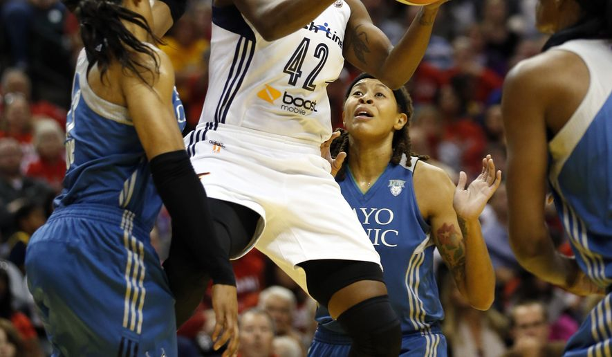 Indiana Fever guard Shenise Johnson (42) goes up for a shot against Minnesota Lynx defense in the first half of Game 3 of the WNBA Finals basketball series, Friday, Oct. 9, 2015, in Indianapolis. (AP Photo/AJ Mast)