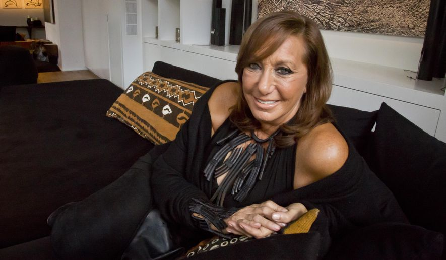 "In this Oct. 5, 2015 photo, fashion designer Donna Karan poses during an interview in New York. Karan has a memoir coming out next week ""My Journey,"" a volume chock full of very personal, entertaining anecdotes.  (AP Photo/Bebeto Matthews)"