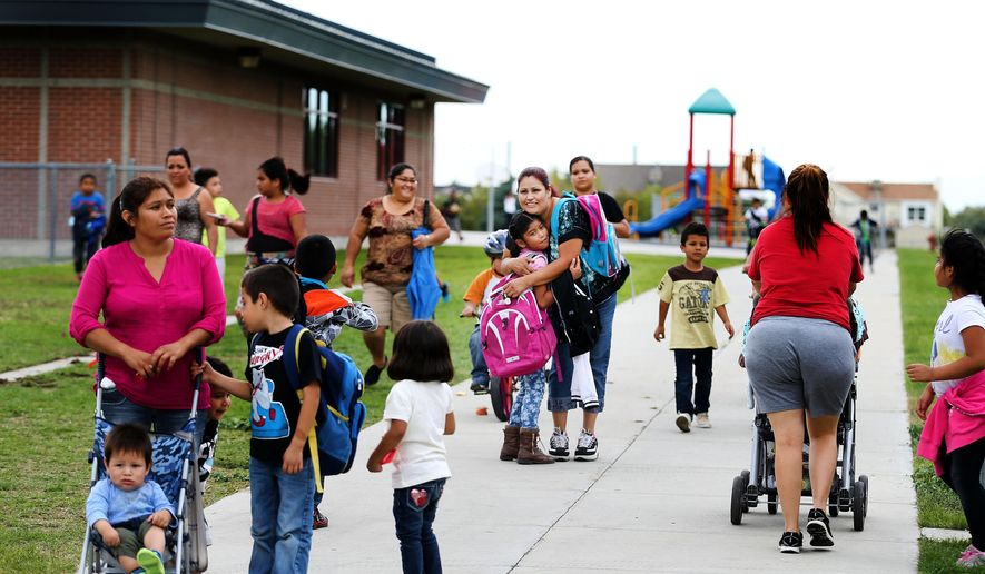 In this photo taken Wednesday, Sept. 30, 2015, students get picked up by their parents after school at Monroe Elementary School in West Valley City, Utah. Chronic absenteeism is a common factor among children living in intergenerational poverty. A new state report says rates of chronic absenteeism are nearly times higher among children experiencing intergenerational poverty than their peers statewide. Monroe Elementary in the Granite School District is making efforts to improve school attendance. (Laura Seitz/The Deseret News via AP)  SALT LAKE TRIBUNE OUT; MAGS OUT; MANDATORY CREDIT; TV OUT