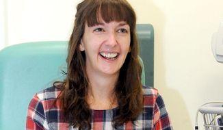 Pauline Cafferkey, a nurse who contracted Ebola while working in Sierra Leone, smiles in the Royal Free Hospital in London on Jan. 1, 2015. (Lisa Ferguson/Scotland on Sunday/PA via Associated Press) **FILE**