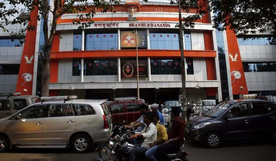 Motorcyclists drive past the Shanmukhananda auditorium where Pakistani singer Ghulam Ali concert was supposed to be held, in Mumbai, India, Friday, Oct. 9, 2015. A local Hindu nationalist party has protested the presence of Ali and forced organizers to cancel his concert in Mumbai, India's entertainment capital. (AP Photo/Rajanish Kakade)