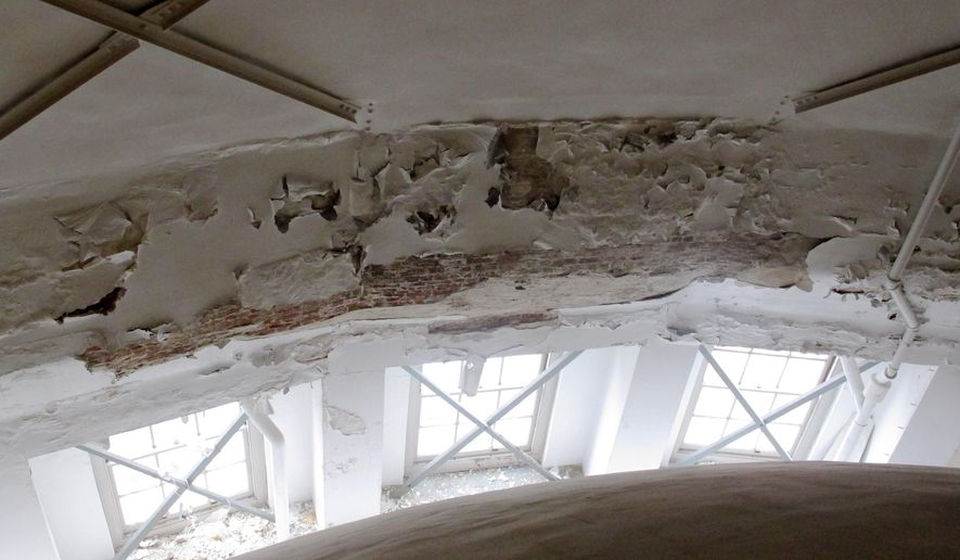 ADVANCE FOR MONDAY, OCT. 12 -- This Oct. 8, 2015 photo shows peeling plaster on the interior dome of the  Wisconsin state Capitol in Madison. Work is under way to repair plaster, marking the end of a series of repairs to the Capitol that began in 1990. (AP Photo/Scott Bauer)