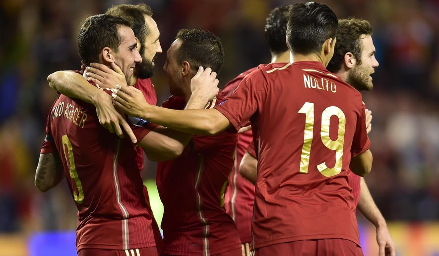 Spain's  Paco Alcantara, left, celebrates his second goal after scoring against Luxembourg,  during their Euro 2016 qualifying soccer match, Group C, between Spain and Luxembourg, at Las Gaunas stadium in Logrono, northern Spain, Friday, Oct. 9, 2015. (AP Photo/Alvaro Barrientos)