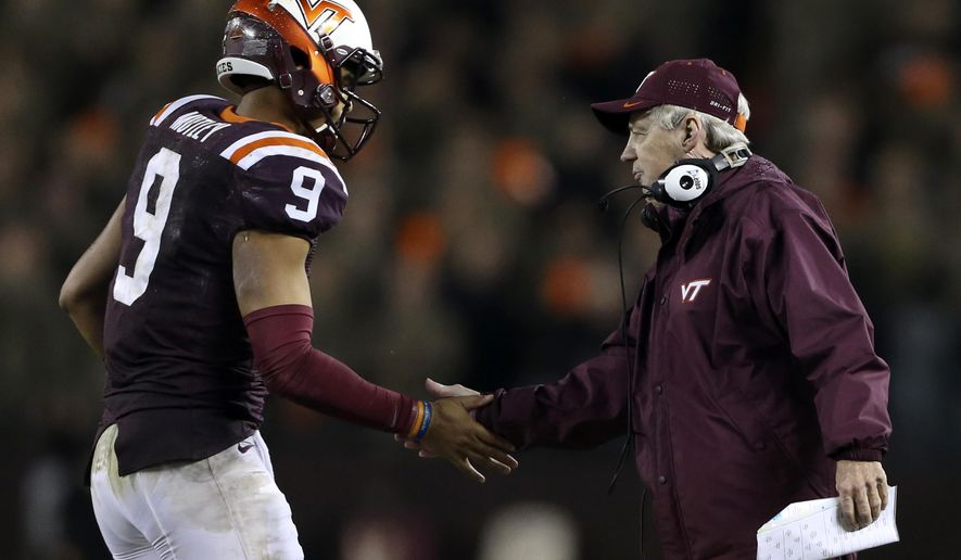 Virginia Tech quarterback Brenden Motley (9) is congratulated by head coach Frank Beamer after his second touchdown pass against North Carolina State during the first half of an NCAA college football game, Friday, Oct. 9, 2015, in Blacksburg, Va. (Matt Gentry/The Roanoke Times via AP) LOCAL TELEVISION OUT; SALEM TIMES REGISTER OUT; FINCASTLE HERALD OUT;  CHRISTIANBURG NEWS MESSENGER OUT; RADFORD NEWS JOURNAL OUT; ROANOKE STAR SENTINEL OUT; MANDATORY CREDIT