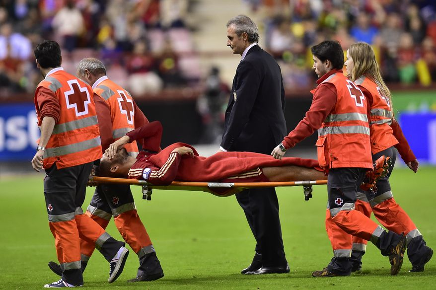 Spain's Alvaro Morata, laments as he leaves the pitch on a stretcher, during their Euro 2016 qualifying soccer match, Group C, between Spain and Luxembourg, at Las Gaunas stadium in Logrono, northern Spain, Friday, Oct. 9, 2015. (AP Photo/Alvaro Barrientos)