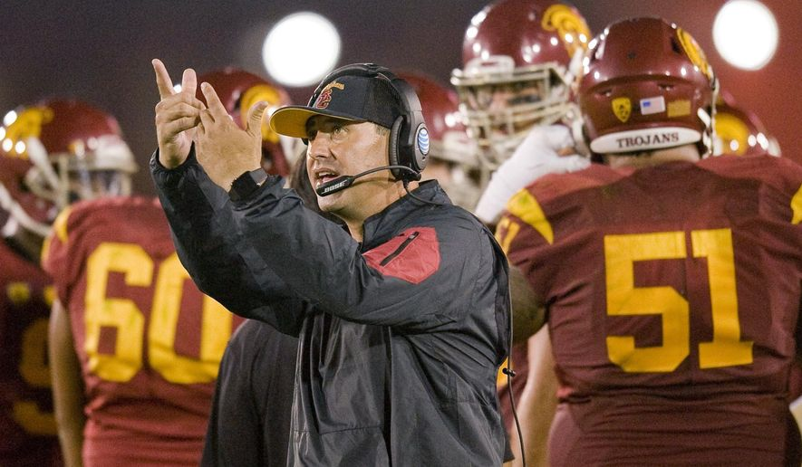 Southern California coach Steve Sarkisian reacts to a replay on the scoreboard during a break in the action against Washington in an NCAA college football game Thursday, Oct. 8, 2015, in Los Angeles. Washington won 17-12. (Paul Rodriguez/The Orange County Register via AP)