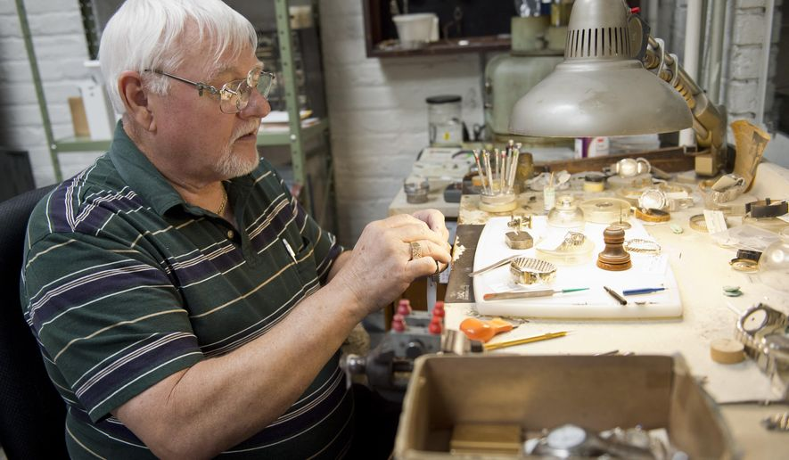 FOR RELEASE SUNDAY, OCTOBER 11, 2015, AT 12:01 A.M. EDT - In this Sept. 22, 2015 photo, Jim Casey repairs a watch at his watch repair bench at Casey Jewelers on Fourth Street in Columbus, Ind. Casey, who has been making and repairing watches in Columbus since 1965, has owned and operated Casey Jewelers since 1972. (Mike Wolanin/The Republic via AP) MANDATORY CREDIT