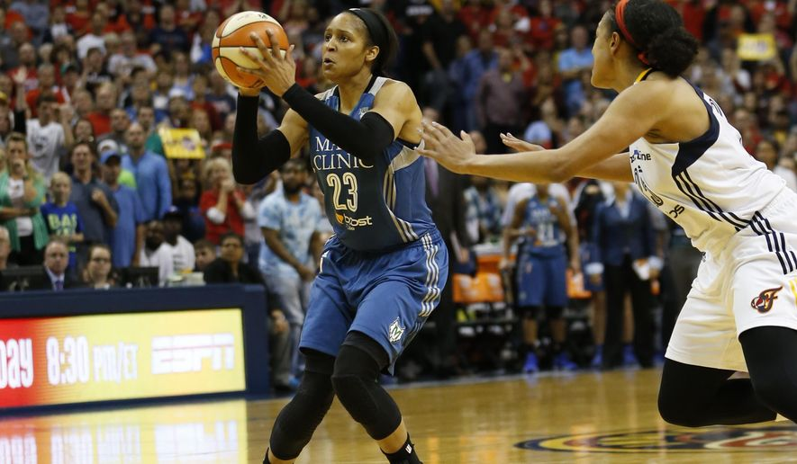 Minnesota Lynx forward Maya Moore (23) shoots a game winning three-pointer in the second half of Game 3 of the WNBA Finals basketball series against the Indiana Fever, Friday, Oct. 9, 2015, in Indianapolis. Lynx won 80-77. (AP Photo/AJ Mast)