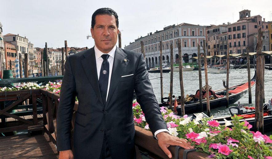 Joe Tacopina poses for photographers in Venice, Italy, Friday, Oct. 9, 2015. New York lawyer Joe Tacopina leads a group of investors who have purchased Venice's fourth-division soccer club. Tacopina and fellow American investors John Goldman and John Tapinis announced the purchase of Venezia FC in the lagoon city Friday. (AP Photo/Luigi Costantini)
