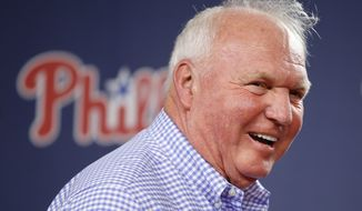 Former Philadelphia Phillies manager Charlie Manuel smiles before speaking at a news conference before a baseball game against the New York Mets, Saturday, Aug. 9, 2014, in Philadelphia. (AP Photo/Matt Slocum)