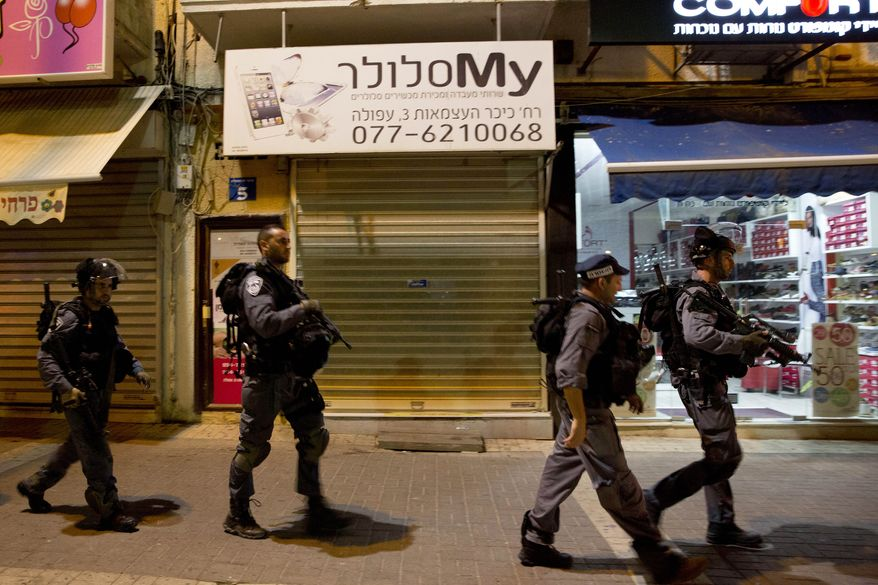 Israeli police officers patrol near the site of a stabbing attack in Afula, northern Israel, Thursday, Oct. 8, 2015. After attacks in Jerusalem and the West Bank left two Israelis seriously wounded Thursday, the violence spread deeper into Israel when police said an Arab attacker stabbed and moderately wounded an Israeli soldier in Afula. (AP Photo/Ariel Schalit)