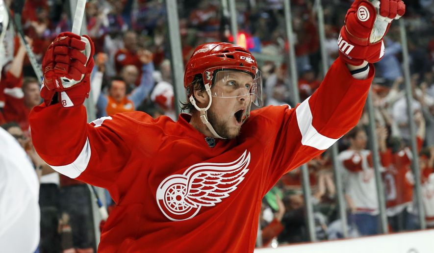 Detroit Red Wings' Justin Abdelkader celebrates his goal against the Toronto Maple Leafs in the second period of an NHL hockey game in Detroit Friday, Oct. 9, 2015. It was Abdelkader's third goal of the game. (AP Photo/Paul Sancya)