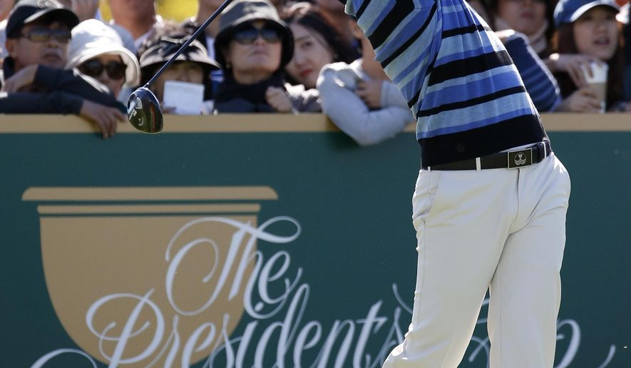 International team player Sangmoon Bae of South Korea hits a tee shot on the fourth hole during his four ball match at the Presidents Cup golf tournament at the Jack Nicklaus Golf Club Korea, in Incheon, South Korea, Friday, Oct. 9, 2015.(AP Photo/Lee Jin-man)