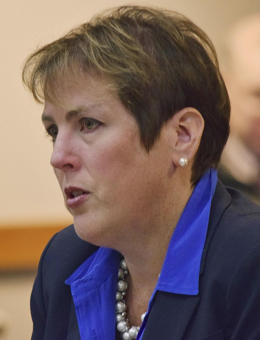 In this Wednesday, Oct. 7, 2015 photo, Angela Rodell, newly named executive director of the Alaska Permanent Fund Corporation, answers questions from the corporation's board of trustees in Juneau, Alaska. (James Brook/The Juneau Empire via AP) MANDATORY CREDIT
