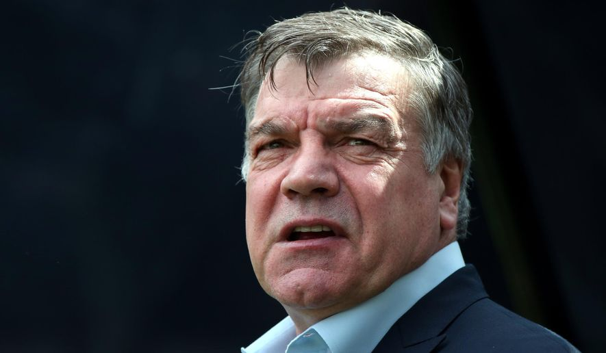 """FILE - In this Sunday, May 24, 2015 file photo, Sam Allardyce waits at the start of their English Premier League soccer match between Newcastle United and West Ham United's  at St James' Park, Newcastle, England. Sunderland says it has hired Sam Allardyce as its new manager on a two-year contract. Allardyce replaces Dick Advocaat after the Dutchman quit last weekend following a 2-2 draw at home to West Ham. Sunderland surrendered a two-goal lead in the game and has only three points from eight matches so far in the Premier League, leaving it second from bottom in the standings. Allardyce says """"I hope to be able to help to bring the stability and success that everyone wants."""" (AP Photo/Scott Heppell, file)"""