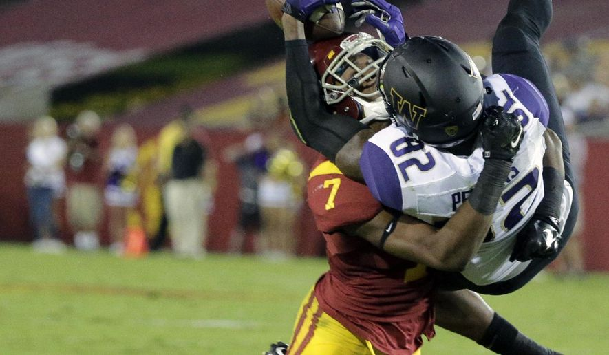 Washington's Joshua Perkins, right, is tackled by Southern California safety Marvell Tell III during the first half of an NCAA college football game, Thursday, Oct. 8, 2015, in Los Angeles. (AP Photo/Jae C. Hong)