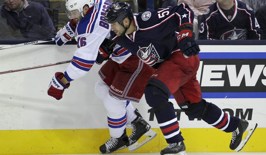 New York Rangers' Derick Brassard, left, and Columbus Blue Jackets' Fedor Tyutin, of Russia, chase a loose puck during the third period of an NHL hockey game Friday, Oct. 9, 2015, in Columbus, Ohio. The Rangers beat the Blue Jackets 4-2. (AP Photo/Jay LaPrete)