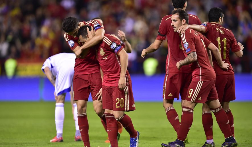 Spain's Santi Cazorla, second left, celebrates with teammates after scoring during their Euro 2016 qualifying soccer match, Group C, between Spain and Luxembourg, at Las Gaunas stadium in Logrono, northern Spain, Friday, Oct. 9, 2015. (AP Photo/Alvaro Barrientos)