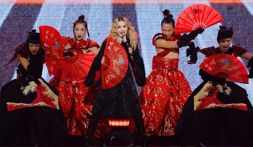 Pop superstar Madonna performs at the Xcel Energy Center in St. Paul, Minn. on Thursday, Oct. 8, 2015. A few hours after the show, Madonna and a few lucky fans saw Prince perform a private concert at his Paisley Park studios in Chanhassen, Minn.  (John Autey/Pioneer Press via AP) MANDATORY CREDIT