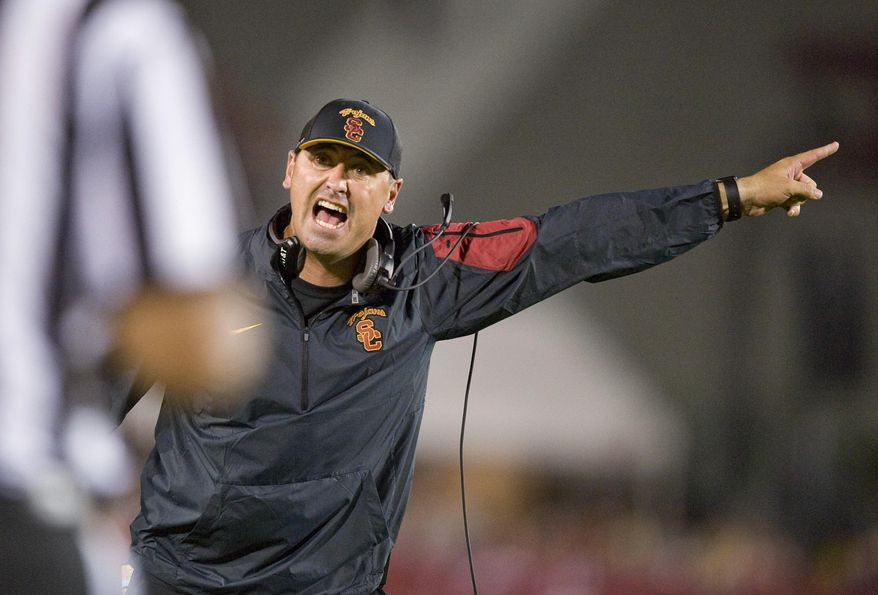 Southern California coach Steve Sarkisian yells at an official late in the fourth quarter against Washington during an NCAA college football game Thursday, Oct. 8, 2015, in Los Angeles. Washington won 17-12. (Paul Rodriguez/The Orange County Register via AP)