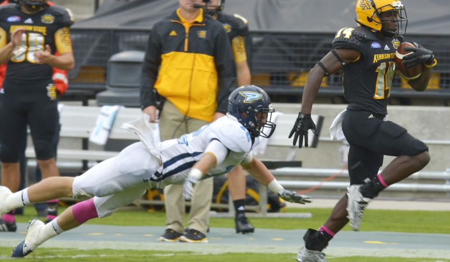 Kennesaw State running back Chasten Bennett (14) runs toward the end zone for a touchdown against Point linebacker Luke Lynch (12) during the first half of an NCAA college football game, Saturday, Oct. 10, 2015, in Kennesaw, Ga. (AP Photo/Diane Loos)