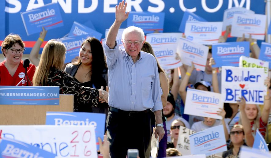 Democratic presidential candidate Sen. Bernie Sanders of Vermont waves to the crowd as he arrives on the stage at the University of Colorado campus in Boulder, Colo., on Saturday, Oct. 10, 2015. (Cliff Grassmick/Daily Camera via AP)