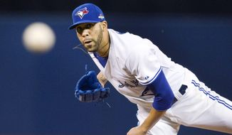 Toronto Blue Jays pitcher David Price throws against the Texas Rangers in the first inning of Game 1 of the American League Division Series in Toronto on Oct. 8, 2015. (Associated Press)