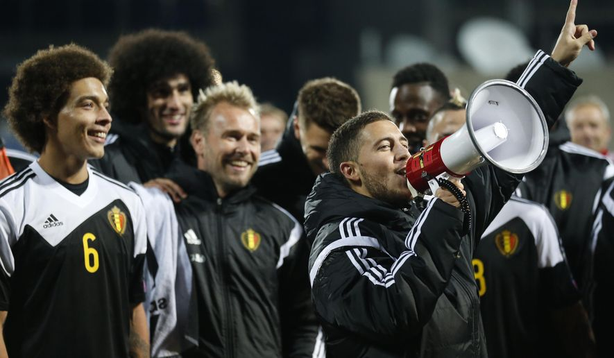 Belgium's Eden Hazard, right, celebrates with a megaphone after his team victory over Andorra during the Euro 2016 group B qualifying match between Andorra and Belgium at the Estadi Nacional stadium in Andorra la Vella, Andorra, Saturday, Oct. 10, 2015. (AP Photo/Manu Fernandez)