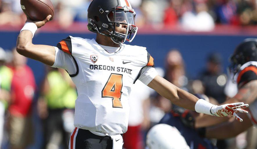 Oregon State quarterback Seth Collins throws down field against Arizona during the first half of an NCAA college football game, Saturday, Oct. 10, 2015, in Tucson, Ariz. (AP Photo/Rick Scuteri)