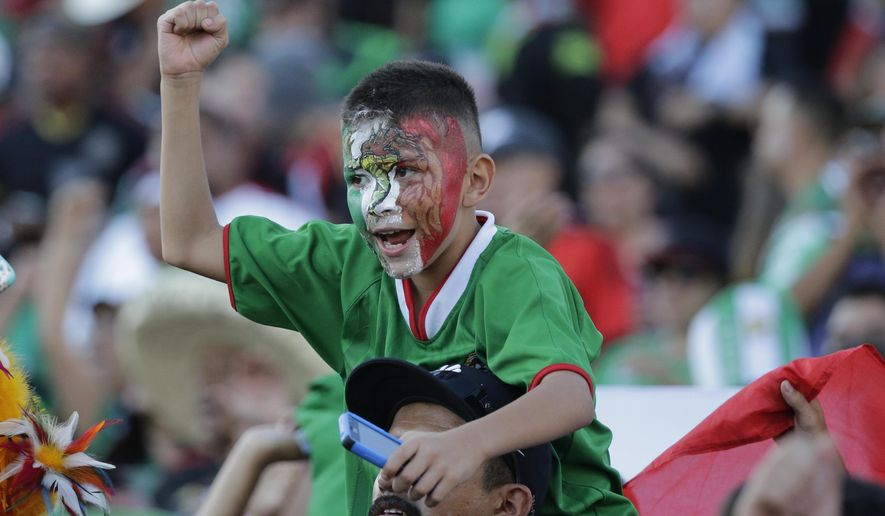 A young fan of Mexico cheers prior to the CONCACAF Confederations Cup playoff soccer match between Mexico and United States at the Rose Bowl Stadium, in Pasadena , Calif. Saturday, Oct. 10, 2015, (AP Photo/Jae C. Hong)