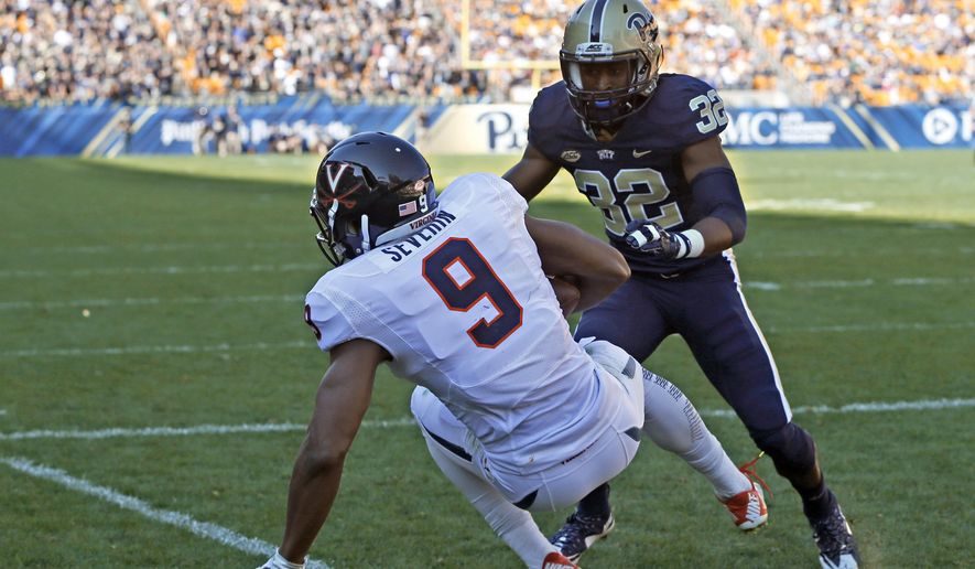 Virginia wide receiver Canaan Severin (9) makes a touchdown catch past Pittsburgh defensive back Phillipie Motley (32) in the fourth quarter of an NCAA college football game, Saturday, Oct. 10, 2015 in Pittsburgh. Pittsburgh won 26-19. (AP Photo/Keith Srakocic)
